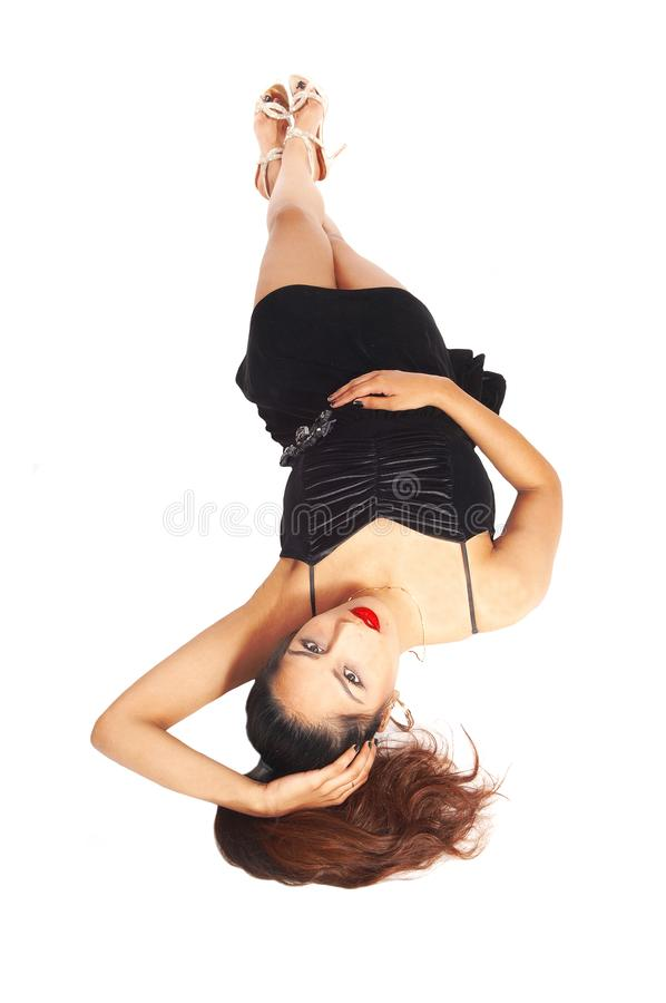 Woman lying in dress on the floor stock images