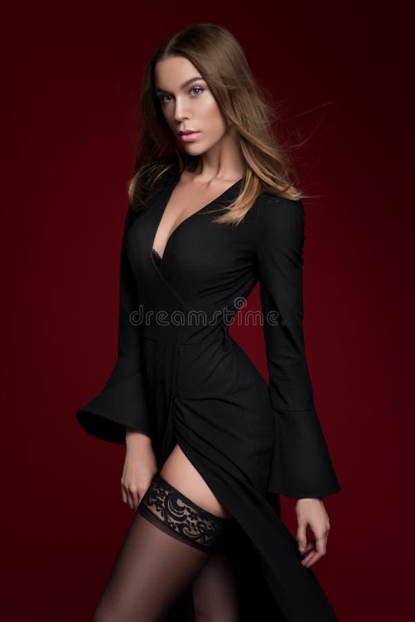 Beautiful woman in black dress stock images