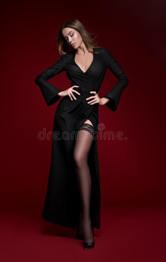Beautiful woman in black dress and stockings royalty free stock image