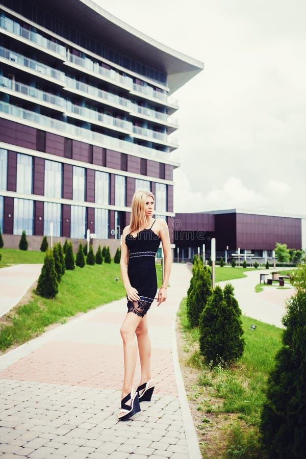 Beautiful woman in black dress stock image
