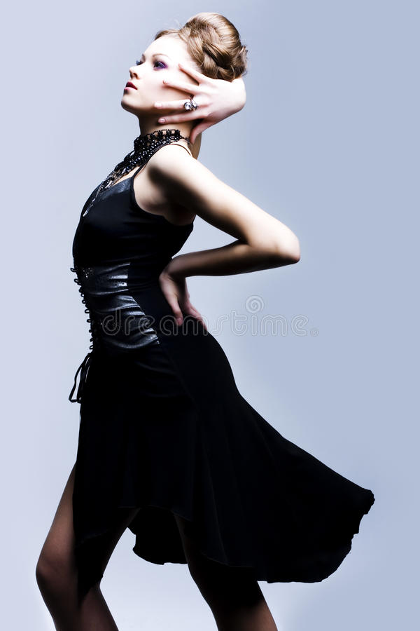 Beautiful woman in black evening gown stock photos