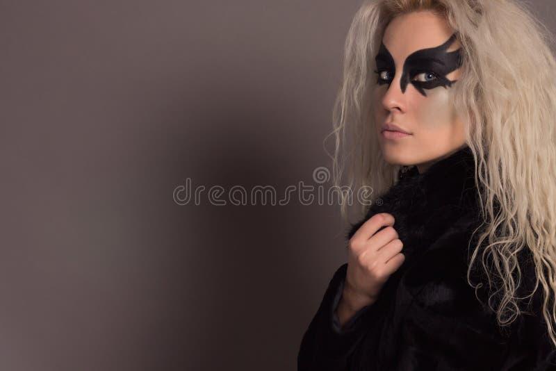 Beautiful Woman in a Black Fur Coat royalty free stock photo