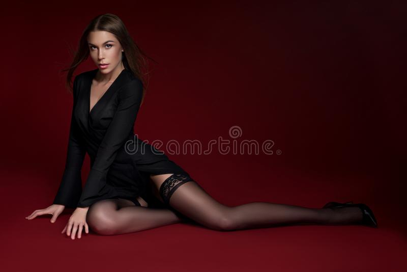 Beautiful woman in black jacket and stockings stock photos