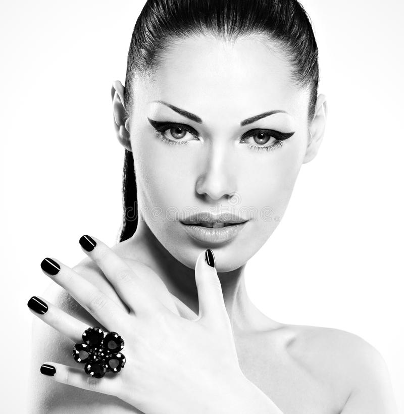 Beautiful woman with black nails. Posing at studio royalty free stock images