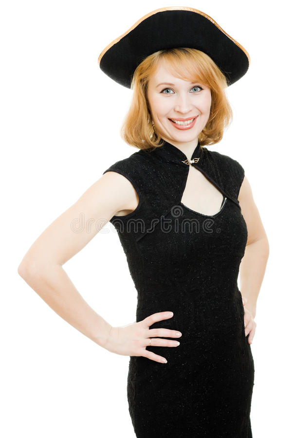 A beautiful woman in a black pirate hat royalty free stock images