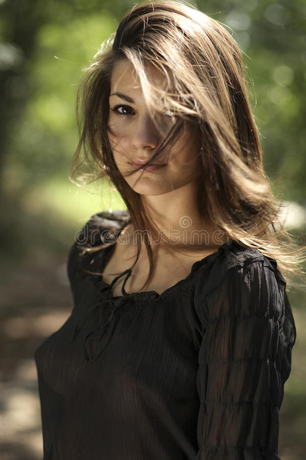 Beautiful woman with black shirt in the park royalty free stock photos