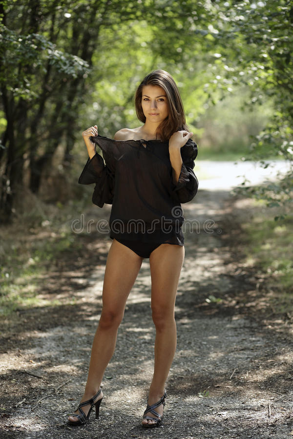 Beautiful woman with black shirt in the park stock photos