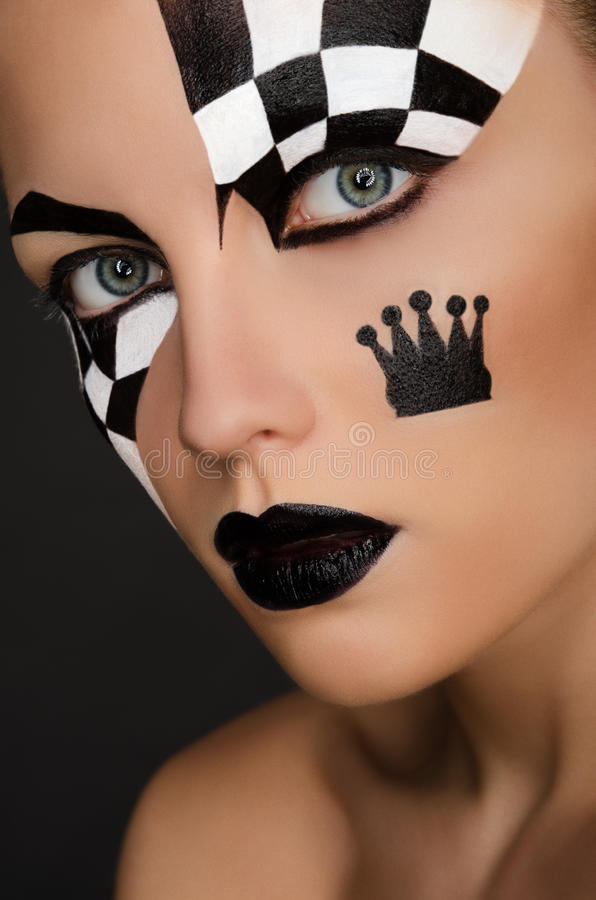 Beautiful woman with black and white face art royalty free stock image