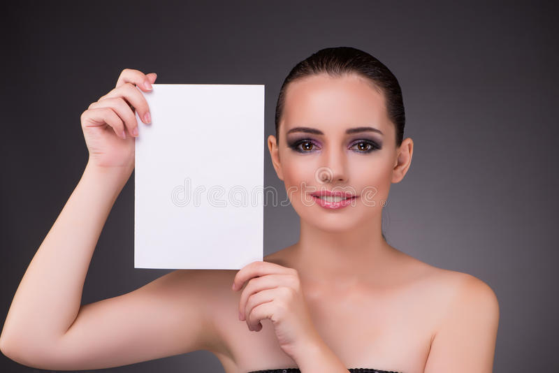 The beautiful woman with blank message paper. Beautiful woman with blank message paper stock photography