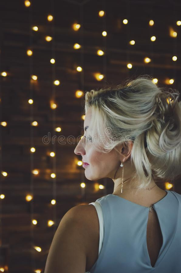 Beautiful woman with blond hair, profile royalty free stock photography