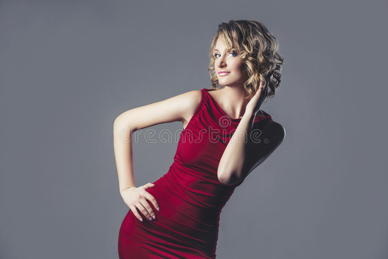 Beautiful woman blonde model in red dress a fashionable and elegant royalty free stock photography