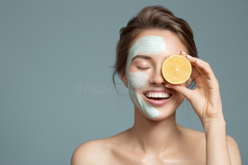 beautiful woman with blue cream mask on her face royalty free stock photography