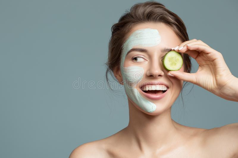 beautiful woman with blue cream mask on her face stock image