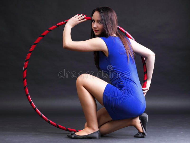 Beautiful woman in blue Dance hoop. Beautiful woman in a sport wear. Dance hoop gym exercises royalty free stock images