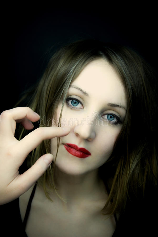 Beautiful woman with blue eyes and red lips royalty free stock images