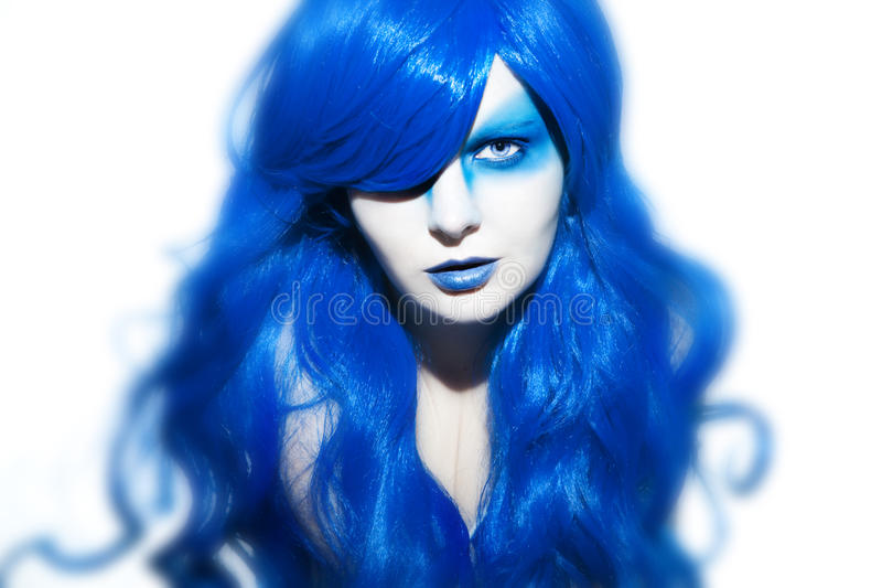 Beautiful woman with blue Hair and Make Up. Studio Shot royalty free stock image