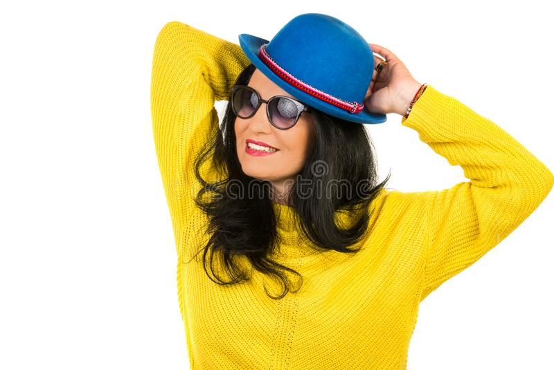 Beautiful woman with blue hat. Beautiful woman posing with sunglasses and blue wool hat isolated on white background royalty free stock photo