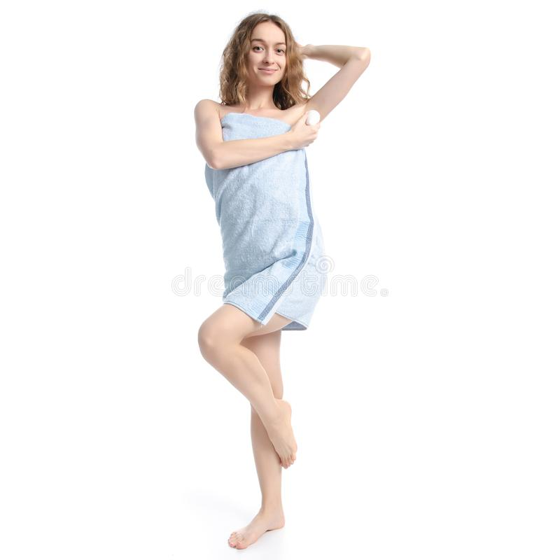 Beautiful woman in blue towel roller antiperspirant in hand beauty body care stock images