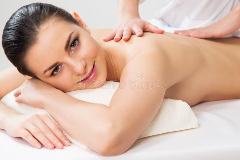 Beautiful woman on a body massage royalty free stock photos