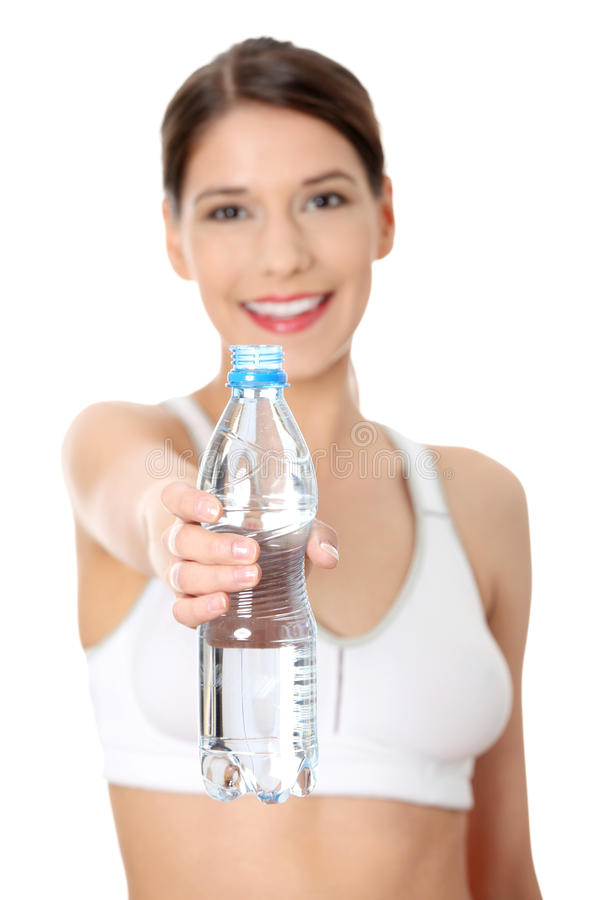 Beautiful woman with bottle of mineral water