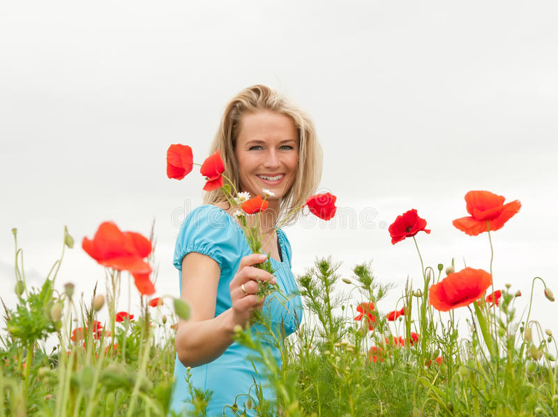 Download Beautiful Woman With Bouquet Stock Photo - Image of grass, outdoors: 25696948
