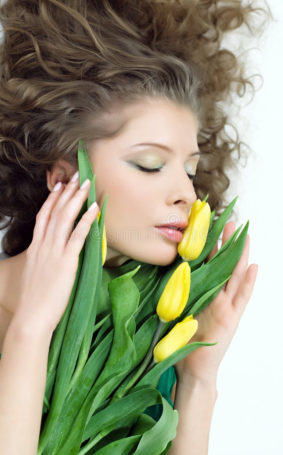 Beautiful woman with the bouquet stock images