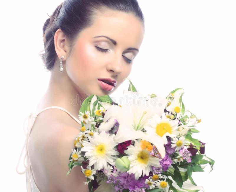 Beautiful woman with bouquet of different flowers royalty free stock photo