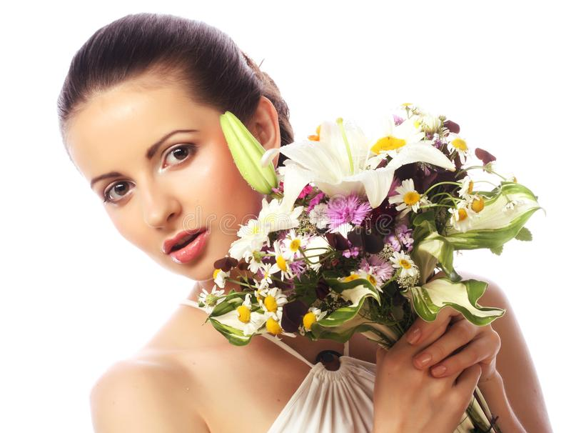 Beautiful woman with bouquet of different flowers stock photos