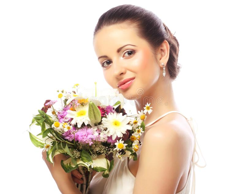 Beautiful woman with bouquet of different flowers royalty free stock photography