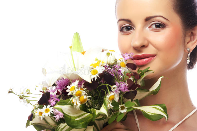 Beautiful woman with bouquet of different flowers royalty free stock image