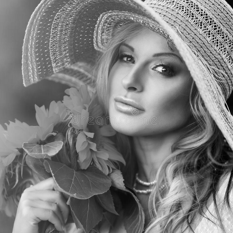 Beautiful woman with a bouquet stock images