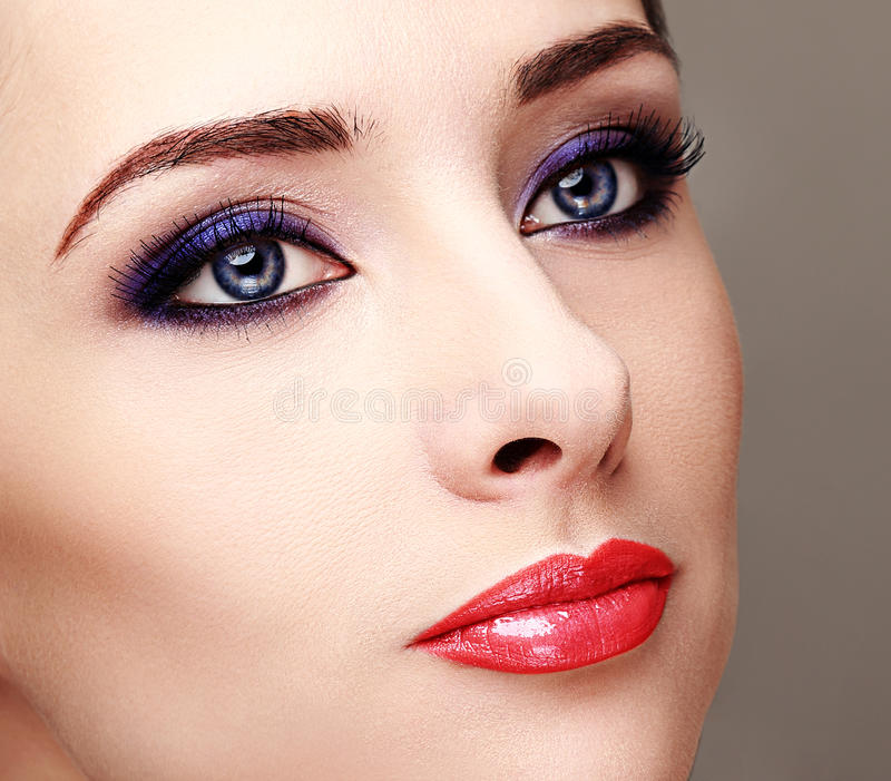 Beautiful woman with bright eyes makeup. And long lashes. Closeup royalty free stock photo