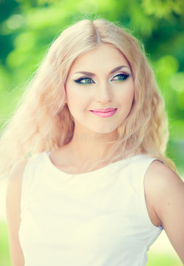 Beautiful woman. With bright makeup and blonde long hair royalty free stock image