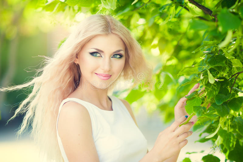 Beautiful woman. With bright makeup and blonde long hair royalty free stock photography
