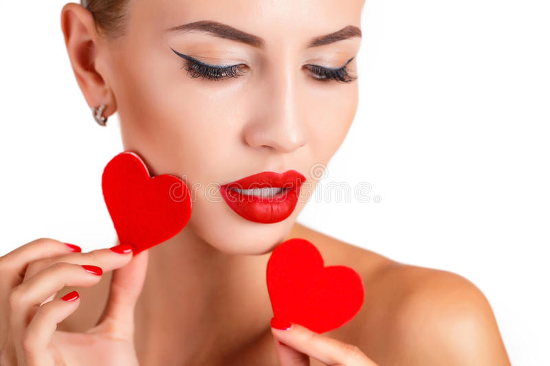 Beautiful woman with bright makeup and red heart royalty free stock image
