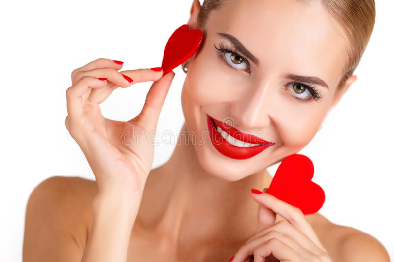 Beautiful woman with bright makeup and red heart stock images