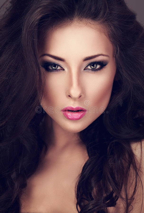 Beautiful woman with bright smokey makeup eyes and pink lipstick. Looking sexy. Closeup toned portrait stock photos