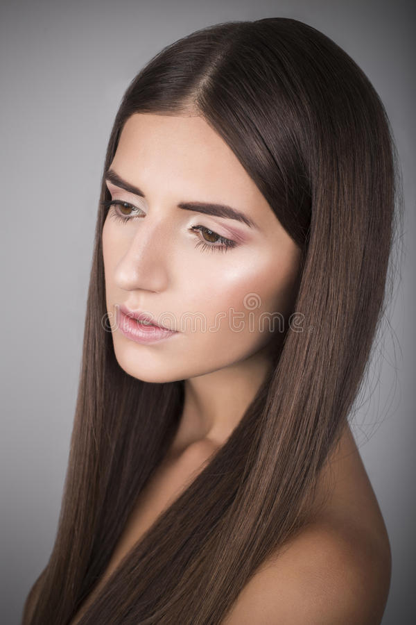 Beautiful woman with brown straight hair royalty free stock images
