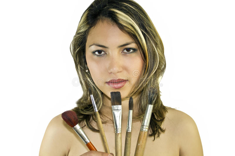 Beautiful woman with brushes. Portrait of beautiful woman with brushes royalty free stock photos