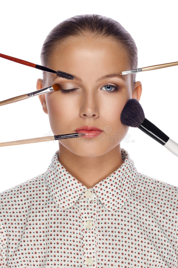 Beautiful woman with brushes for make-up stock images