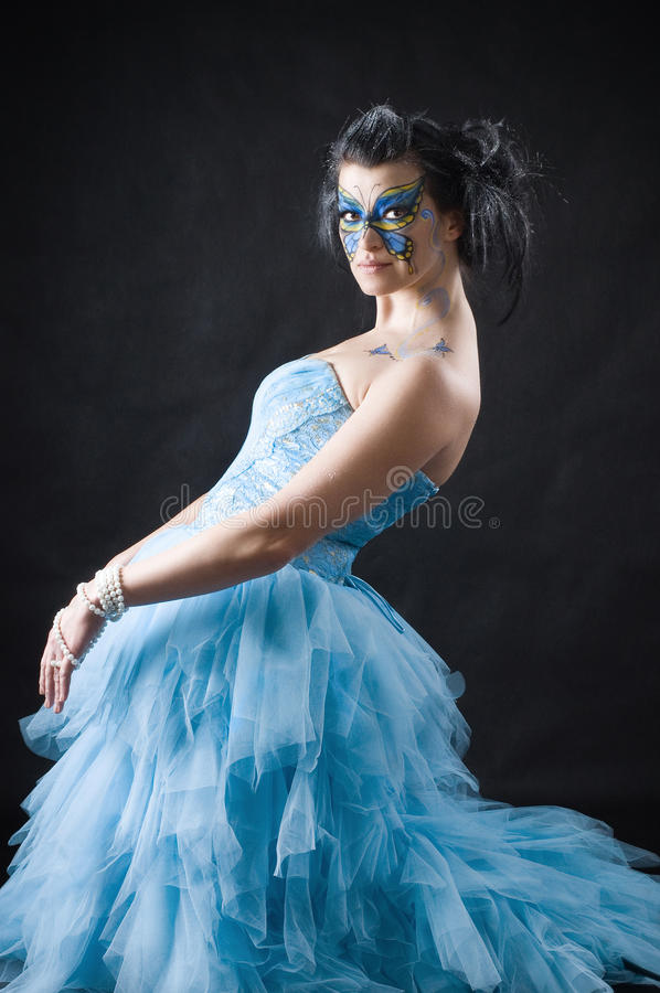 Beautiful woman with butterfly bodyart ot the face stock photography