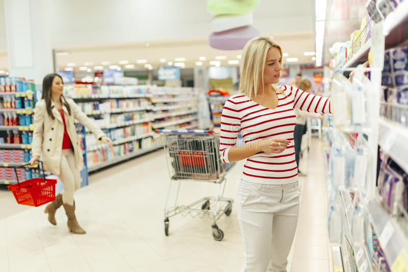 Beautiful woman buying body care products stock images