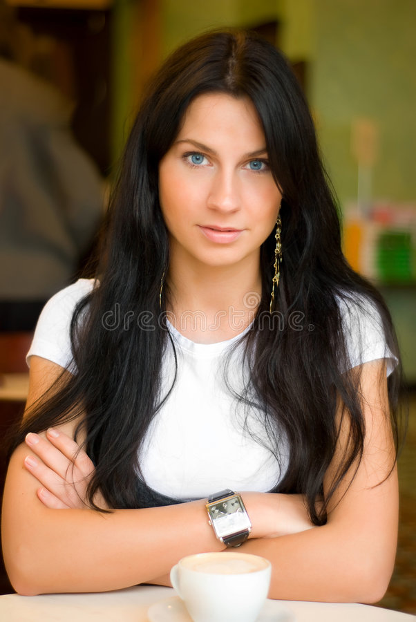 Beautiful woman in cafe royalty free stock photos