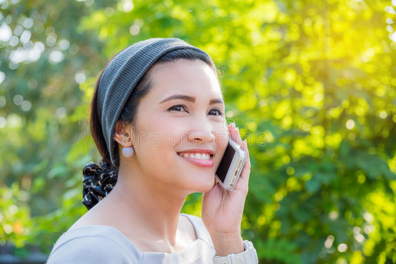 Beautiful woman calling someone by cellphone royalty free stock photo