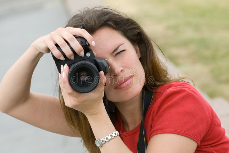 Beautiful woman with camera stock images