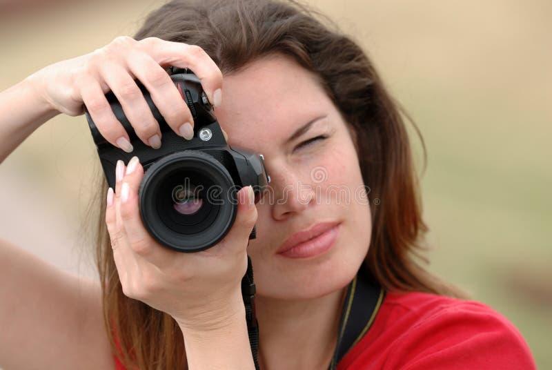 Beautiful woman with camera royalty free stock photo