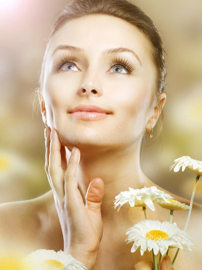 Beautiful Woman with Camomiles royalty free stock image