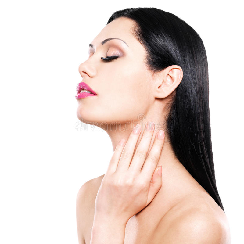 Woman cares of the skin neck stock image