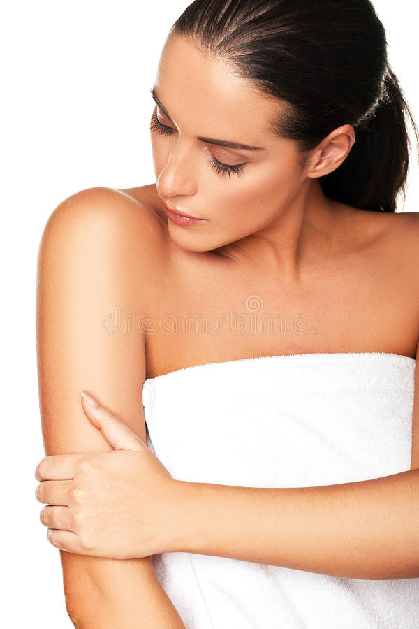 Beautiful Woman Caressing Her Arm Royalty Free Stock Images