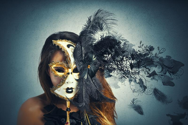 Beautiful woman in carnival mask. With motion effect stock photography
